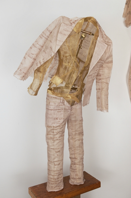 Szymanski_Carol_Cockshut_Offshoots_Banknotes_Suits_2010_D&G_Cotton_silkscreen_on_silk_and_cotton,__brass_40x18_inches.jpg