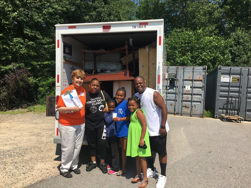 A family receives items from Household Goods donation center in Acton, MA