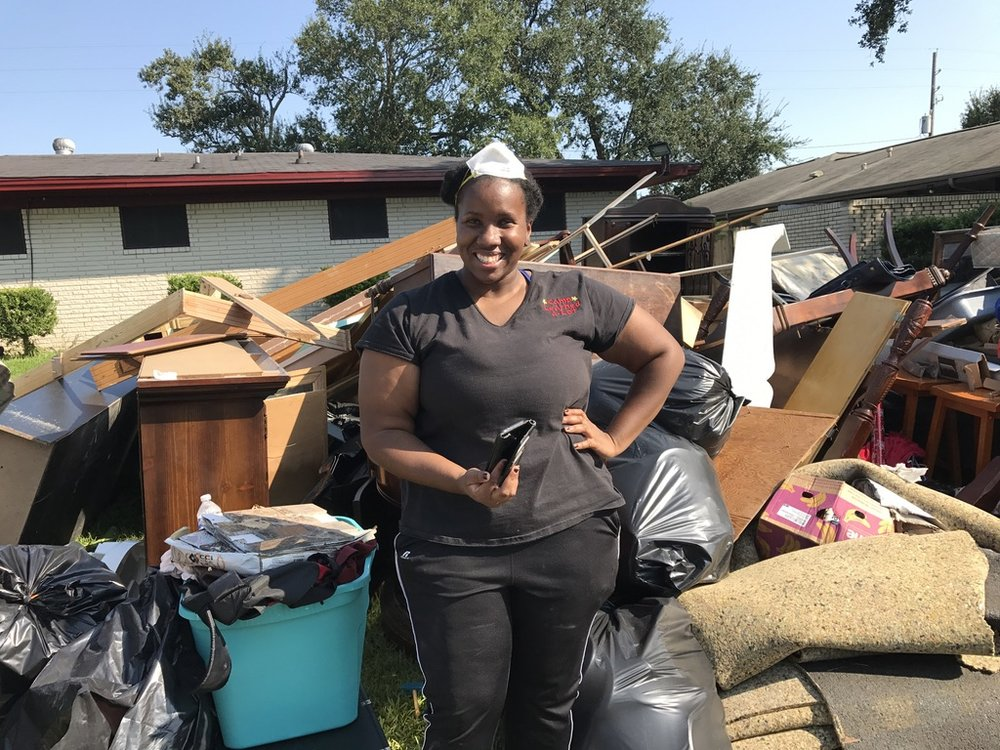 Harvey-Pastor-Maxine-Williams'-daughter-Denetra-Baker-who-came-to-help-clean-out-What-a-great-attitude-and-spirit.jpeg