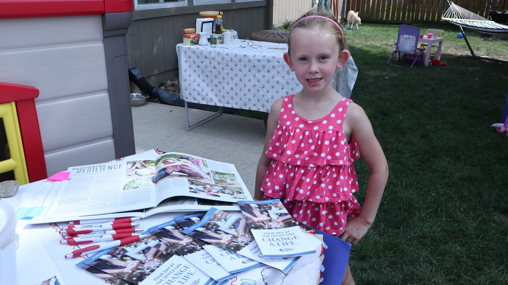 Kinsley with her NCM handouts for her customers