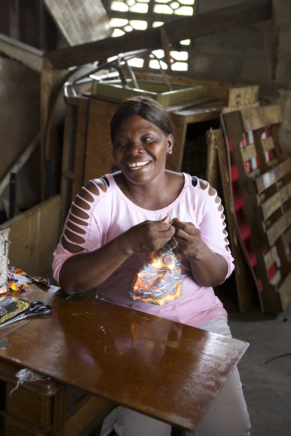 Marie, above, wants to earn money so her children can finish school, something a manipulative guardian prevented her from doing herself. Now, she can gain dignity and respect through her work.