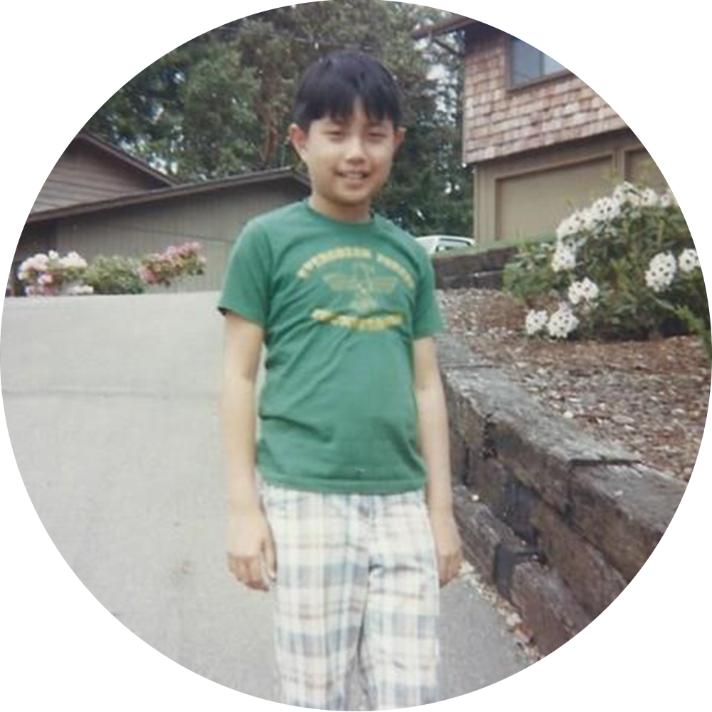 Tom proudly wearing his  Evergreen Forest Thunderbirds T-shirt, 1978