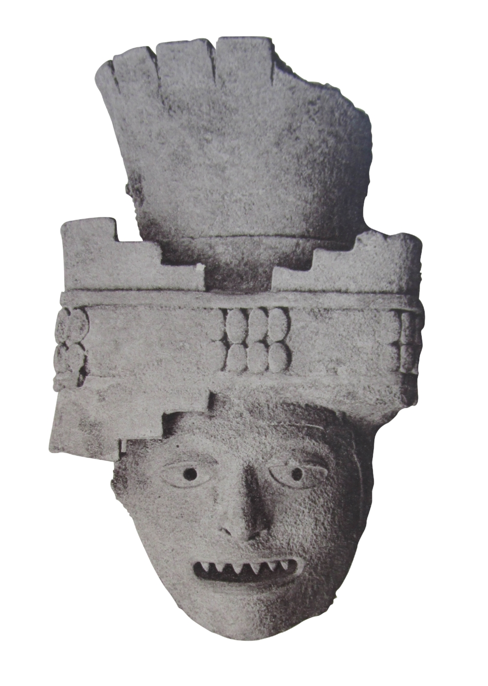 The head of a broken statue that Augustus Le Plongeon found buried in front of the temple at Punta Sur in 1876. It was from statues like this one that Isla Mujeres took her name.