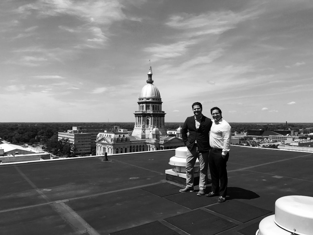 Principal of H&A Property Management standing on Lincoln Tower's rooftop with a colleague (2017)