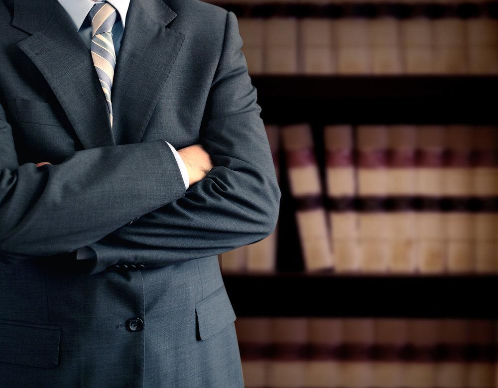 Lawyerinfrontofbooks.jpg