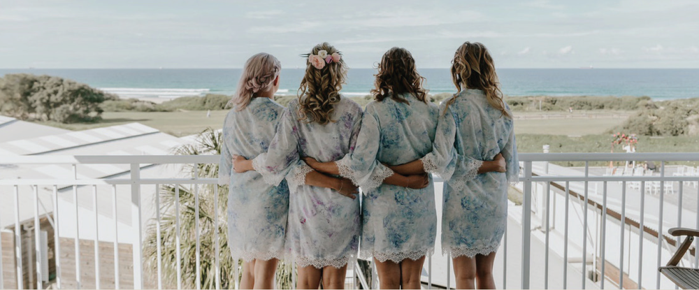 The Bridal Party from a recent Caves Coastal Wedding sinking in the views after a relaxing massage from their villa.