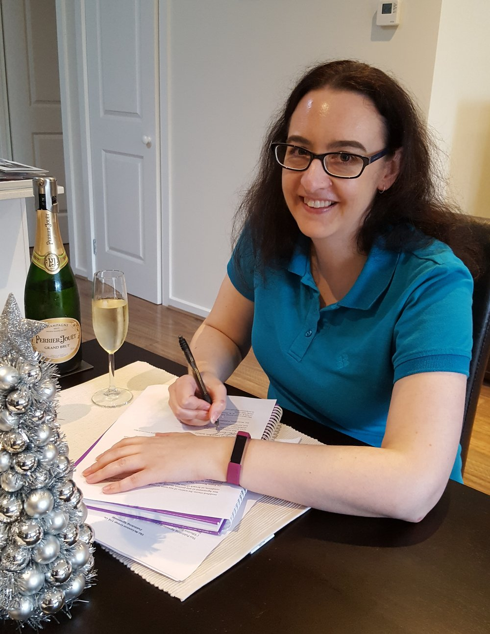 Laurie Bell signing her first book contract with Wyvern's Peak Publishing