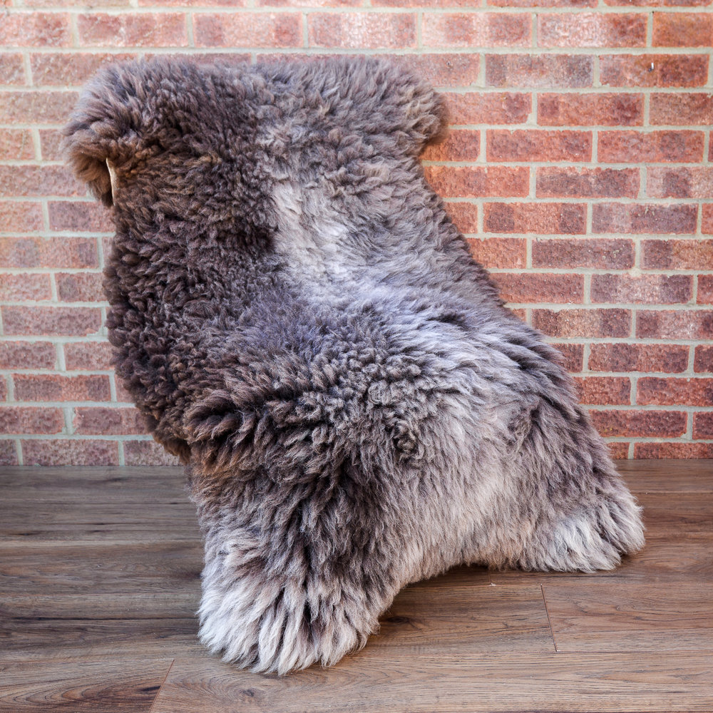 Huge light grey, brown sheepskin rug