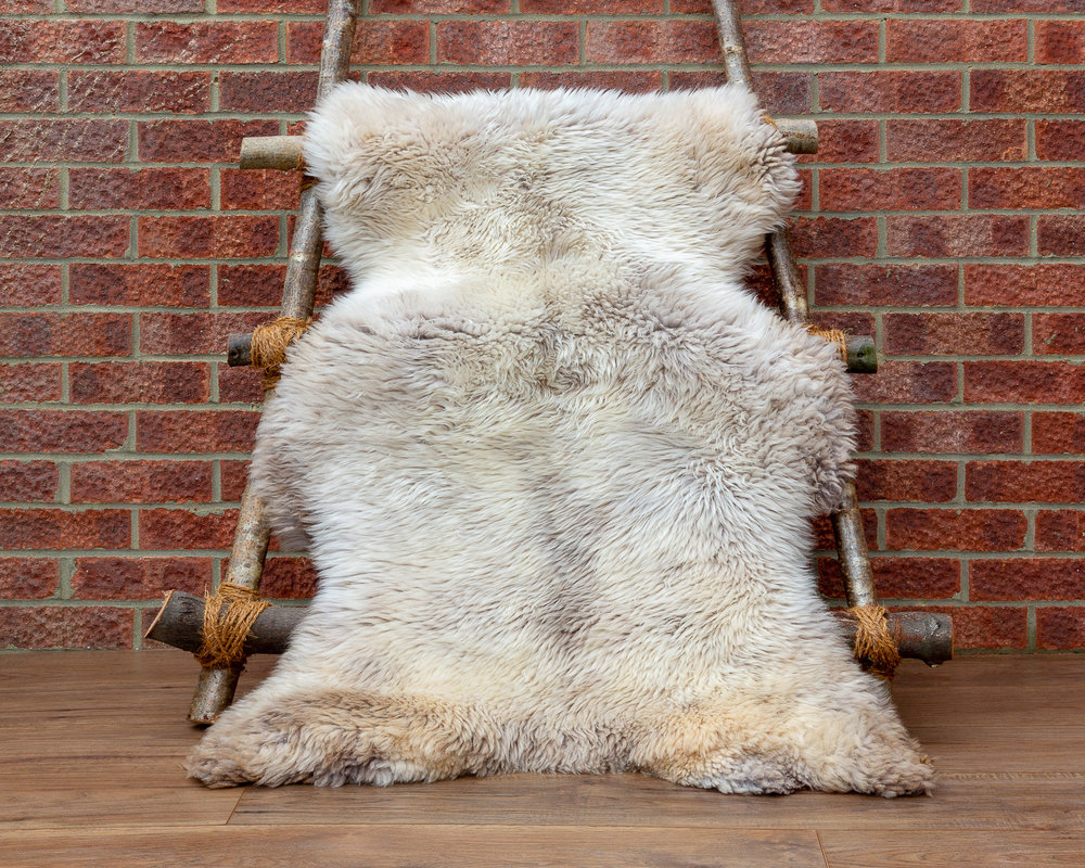 Beige sheepskin rug
