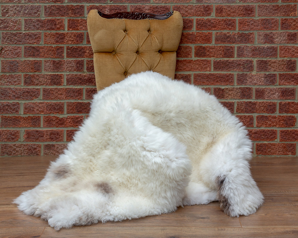 Cream with brown spots sheepskin rug