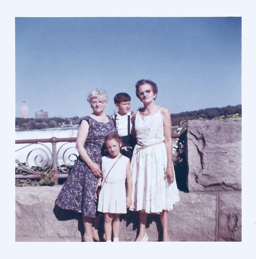 At Niagara Falls. Agnes, in the white dress.