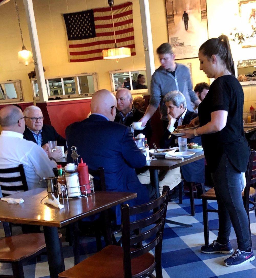 John Kerry pondering his coffee. Chef John Currence in white with his back to the camera.