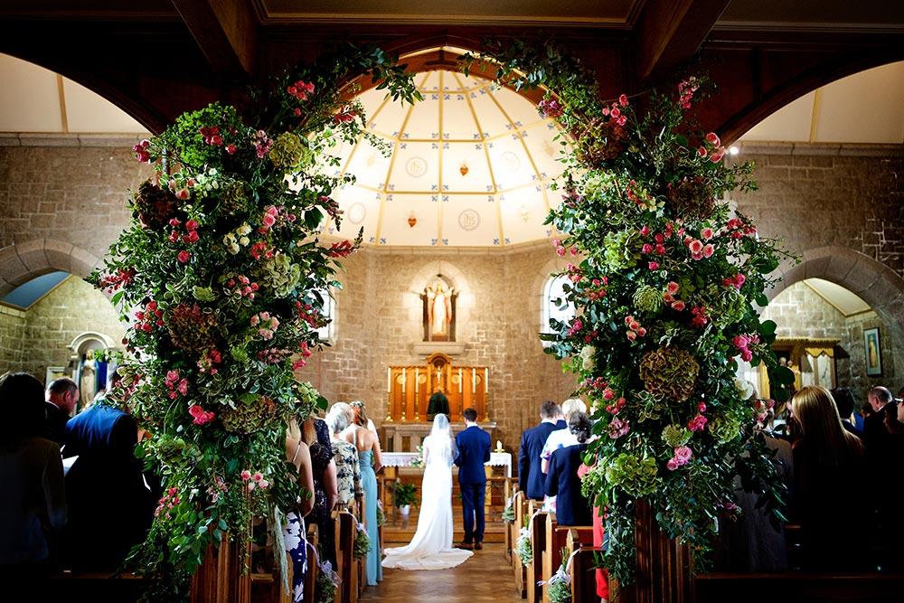 3-wilde-thyme-wedding-event-florist-flowers-church-decor-arch.jpg
