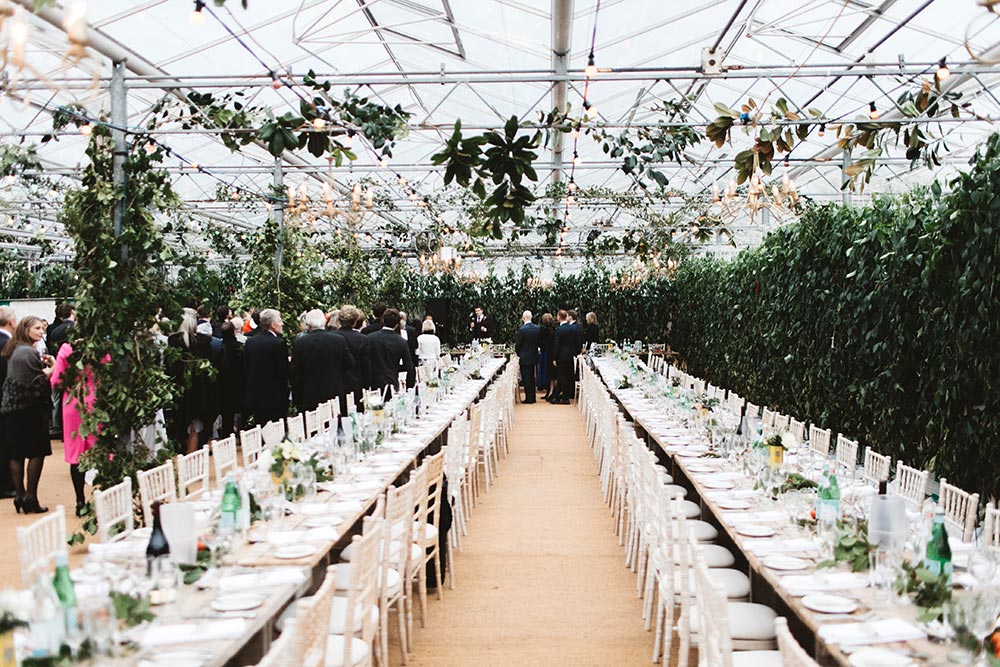 27-wilde-thyme-wedding-event-florist-flowers-green-house-wedding-ceiling-decor-hanging-foliage.jpg