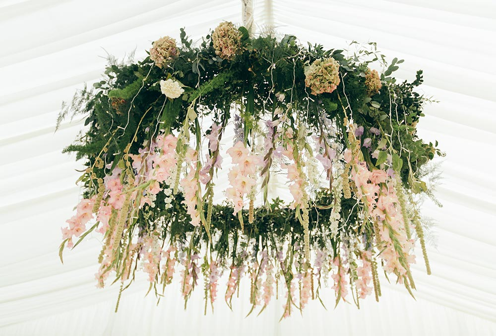 7-wilde-thyme-wedding-flowers-ceiling-installation-hanging-flowers-hoop-marquee-decor-blush-ivory-marquee-solutions.jpg