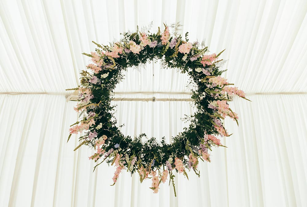 8-wilde-thyme-wedding-flowers-ceiling-installation-hanging-flowers-hoop-marquee-decor-blush-ivory.jpg