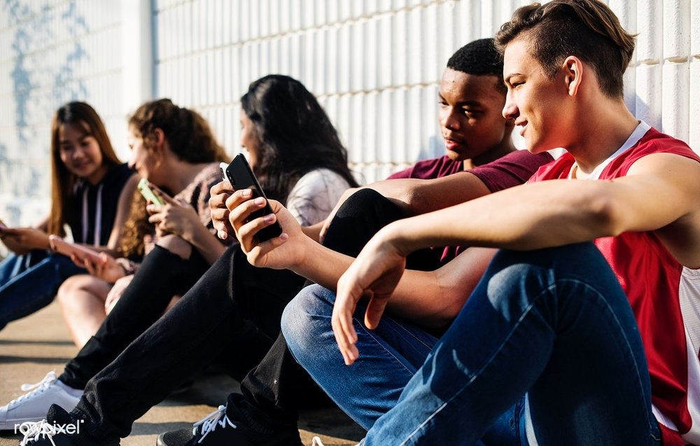 Teens using tech.jpg