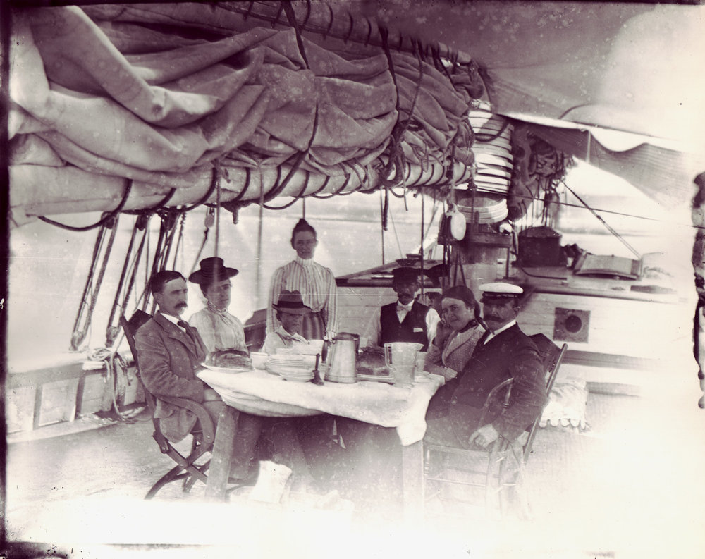A well-to-do family enjoying a summer aboard the  Taber , sailing the waters between Long Island and Newport, circa 1901.
