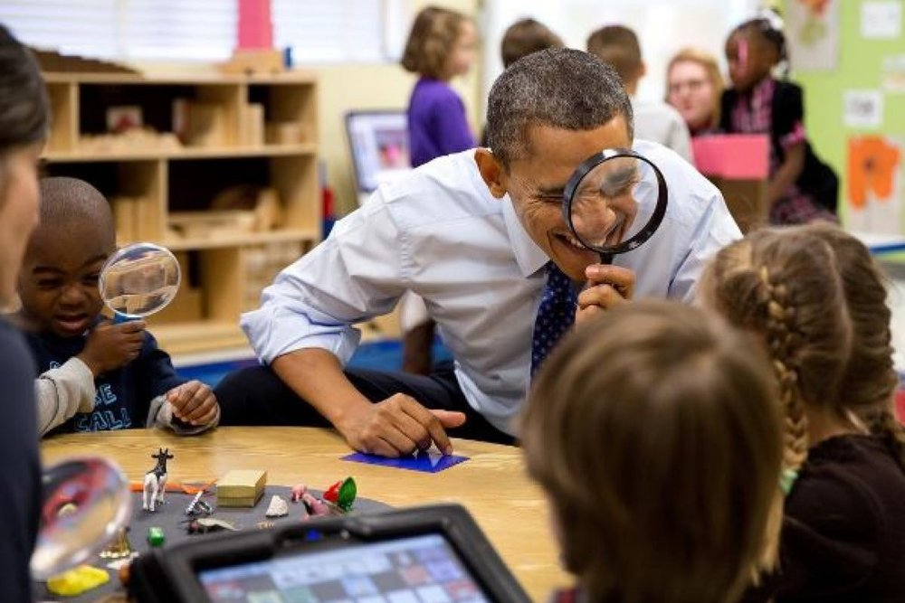 Barack Obama through a magnifying glass courtesy of  Wikimedia Commons .