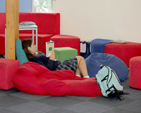 student lying in library.jpg