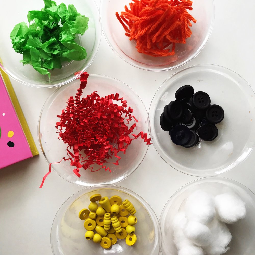 Tissue paper for lettuce, yarn for cheese, gift bag filling for tomatoes, black buttons for black beans, yellow beads for corn, and cotton balls for sour cream!