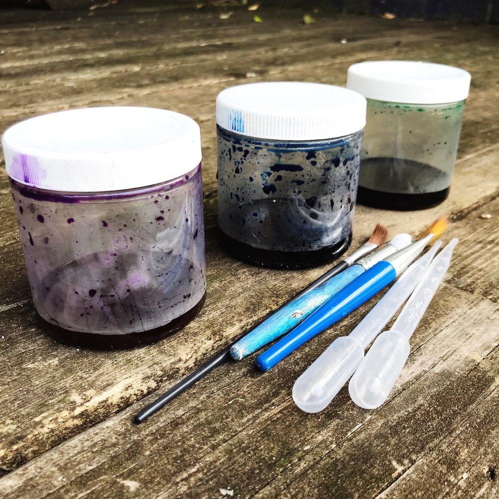 I transported my liquid water colors in these containers, then watered them down in small paper cups for painting.