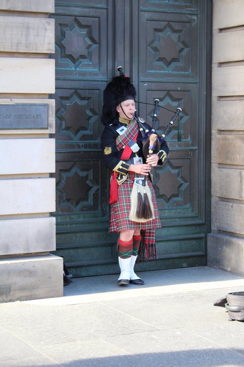A bagpiper on The Royal Mile.