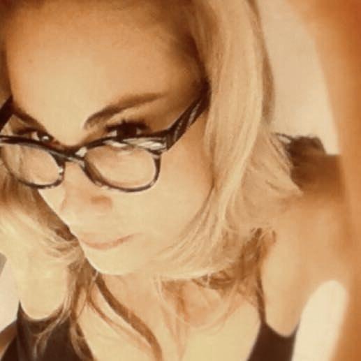 Biz Carlton wears glasses