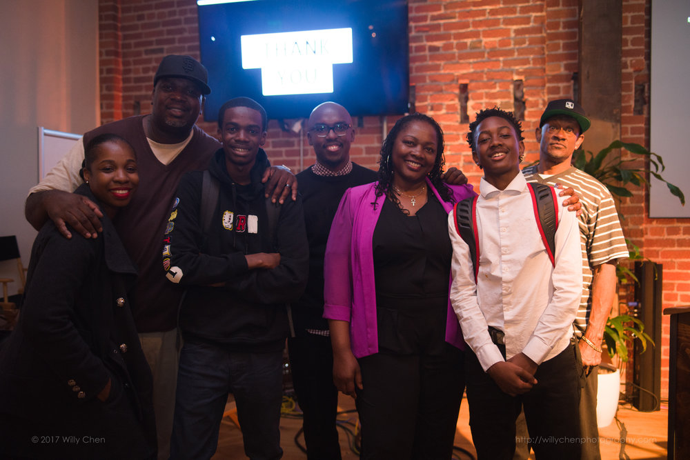 Stevon Cook standing with Mission Bit students and families after Spring 2018 Demo Day
