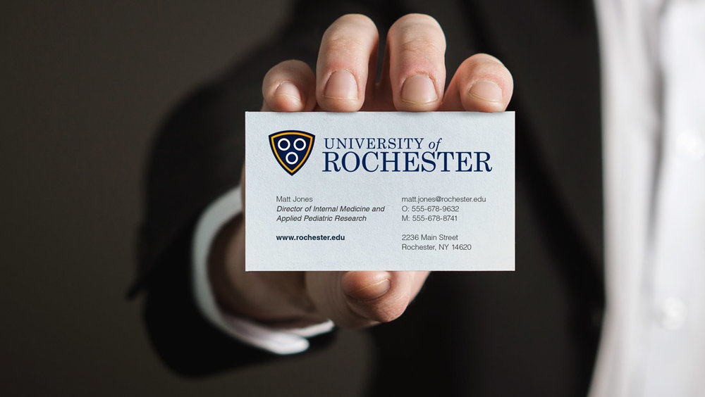 A business card concept featuring the new University of Rochester logo concept from creative marketing firm Insomniac Studios.