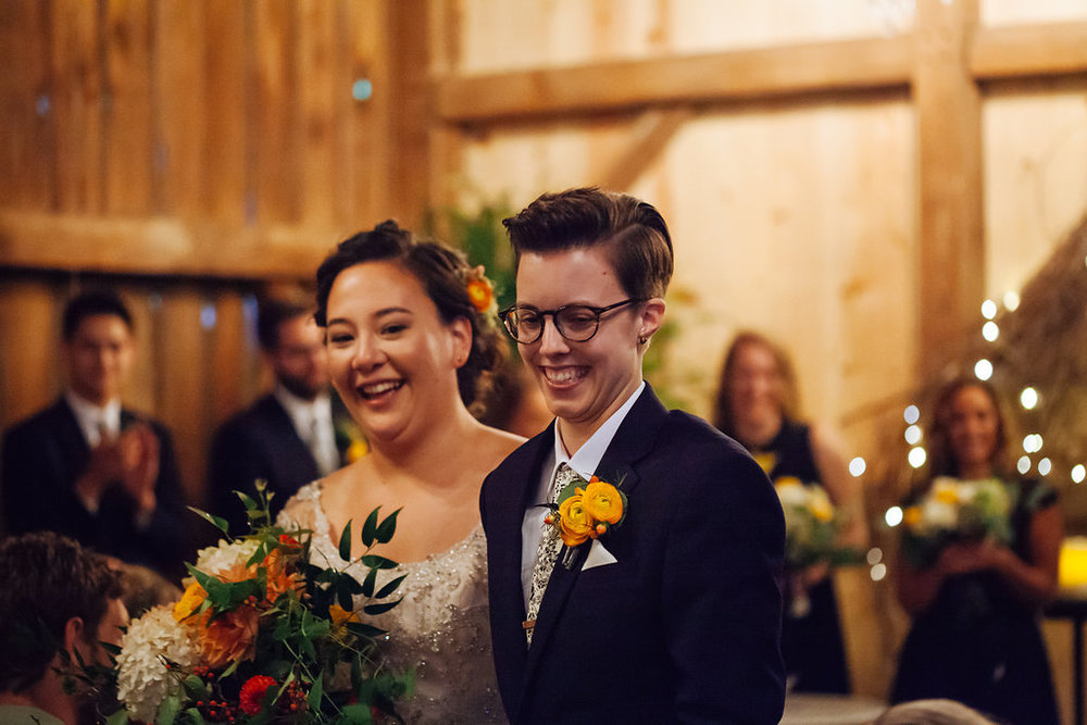 Julia + Johanna wedding ceremony photos | orange ranunculus boutonniere | backup rain plan | Alyssa Lee Photography | Camrose Hill Studios | Sixpence Events day of coordinating