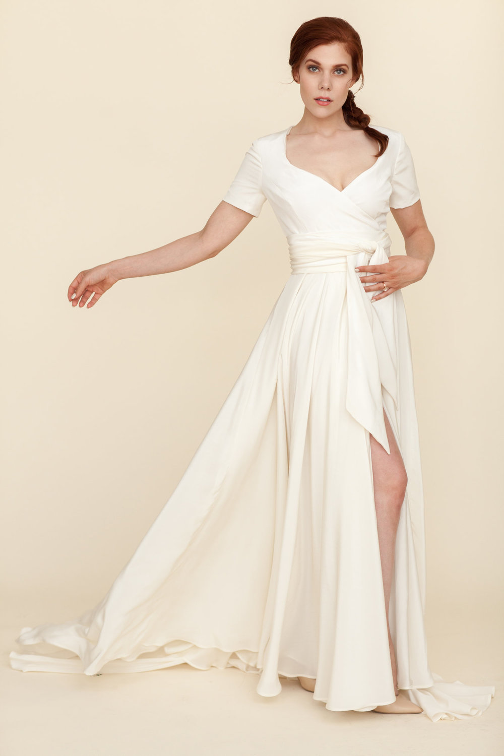 Modehaus Dove | wrap wedding dress with lots of movement | short sleeve wrap dress with dramatic slit