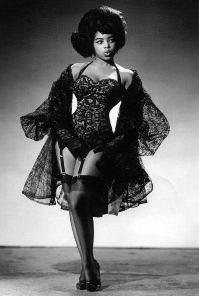 Black and White photograph of Miss Topsy (an African American model) in pin-up.