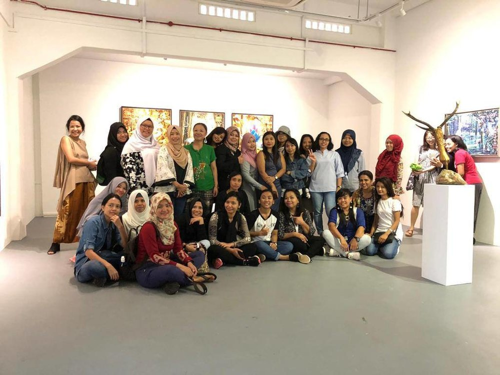 Chan + Hori Contemporary organized a tour of their art gallery for the migrant domestic worker community