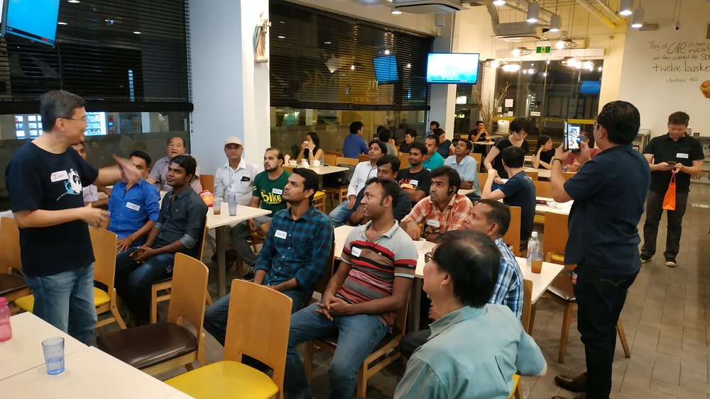 Focolare Men's group organized a 'Dinner of Encounter' to meet Bangladeshi workers, hear their struggles, and why they came to  Singapore