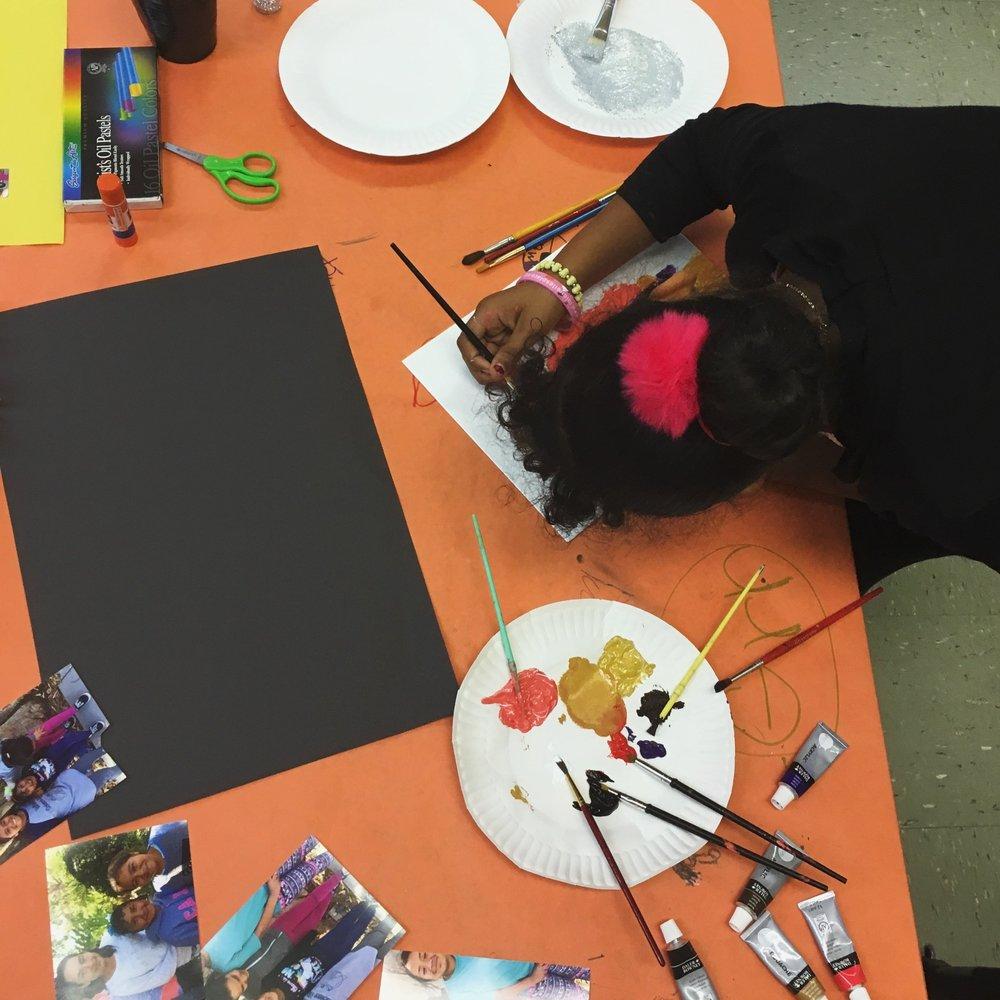 Art Club participant creating a self portrait.