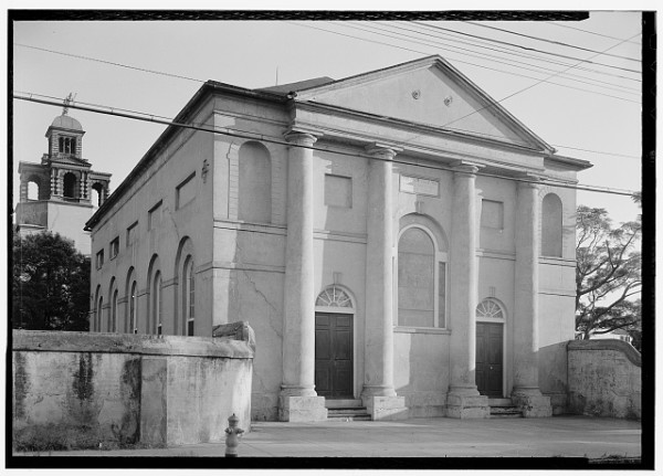The Charleston Orphan House Chapel (1802) at 13 Vanderhorst Street, photographed in 1940 by C.O. Greene. The building was destroyed in the 1950s. The copula of the Orphan House can be seen behind the chapel. HABS, LOC.