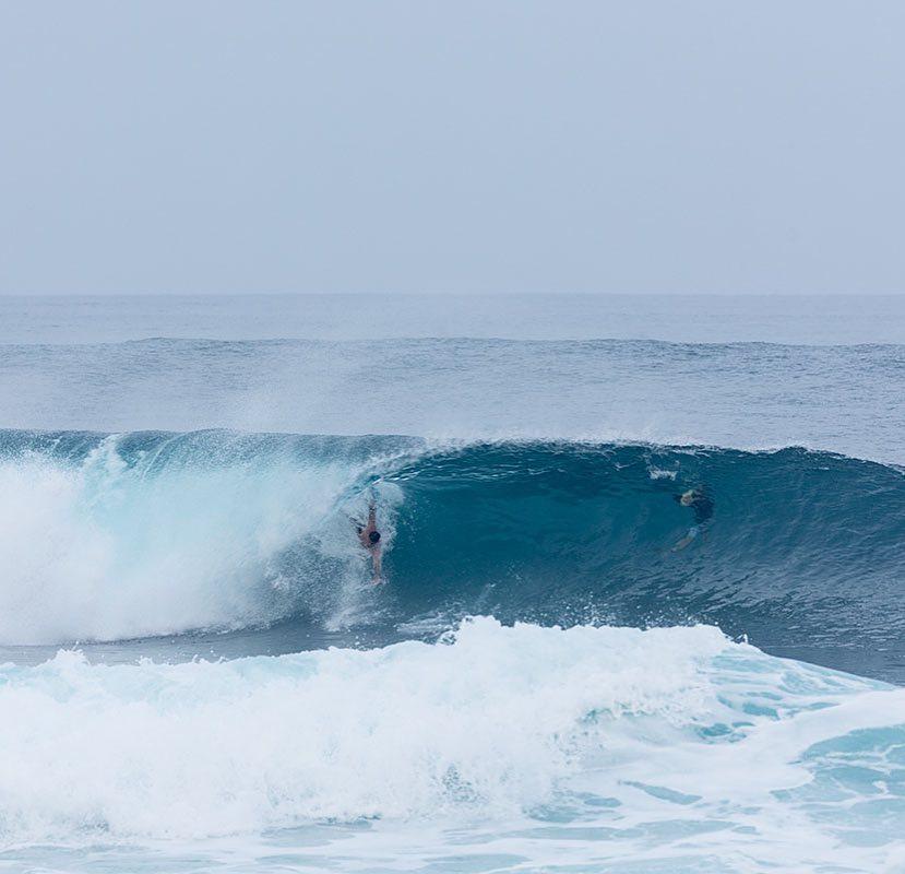 David Ford bodysurfing Banzai Pipeline with his DMC Repellors  Photographer - Sean Davey