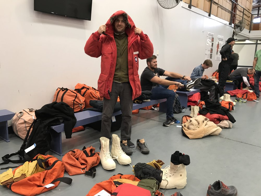B-195-M group member Weston Turner testing out his issued parka and other components of his Extreme Cold Weather (ECW) gear at the USAP Clothing Distribution Center in Christchurch, New Zealand.