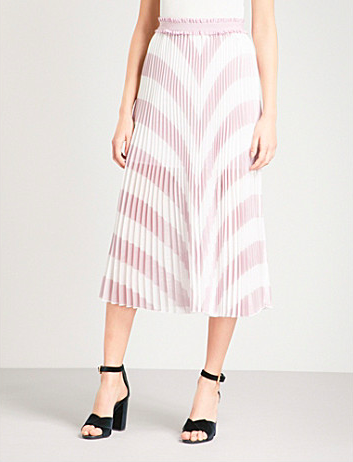 Maje at Selfridges chevron printed skirt. Wear it with a white shirt or pick out the pink in the skirt and toughen it with black heels like above or nude heels.