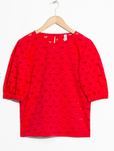 I think this  red butterfly sleeve top by &Other Stories would be brilliant with white jeans and the Boden pompom flats below for a relaxed look. For evening the Kurt Geiger heels.
