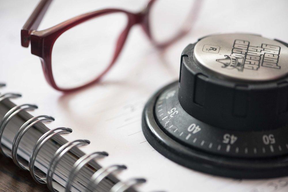 Timer, pair of glasses, writing paper for web.jpg