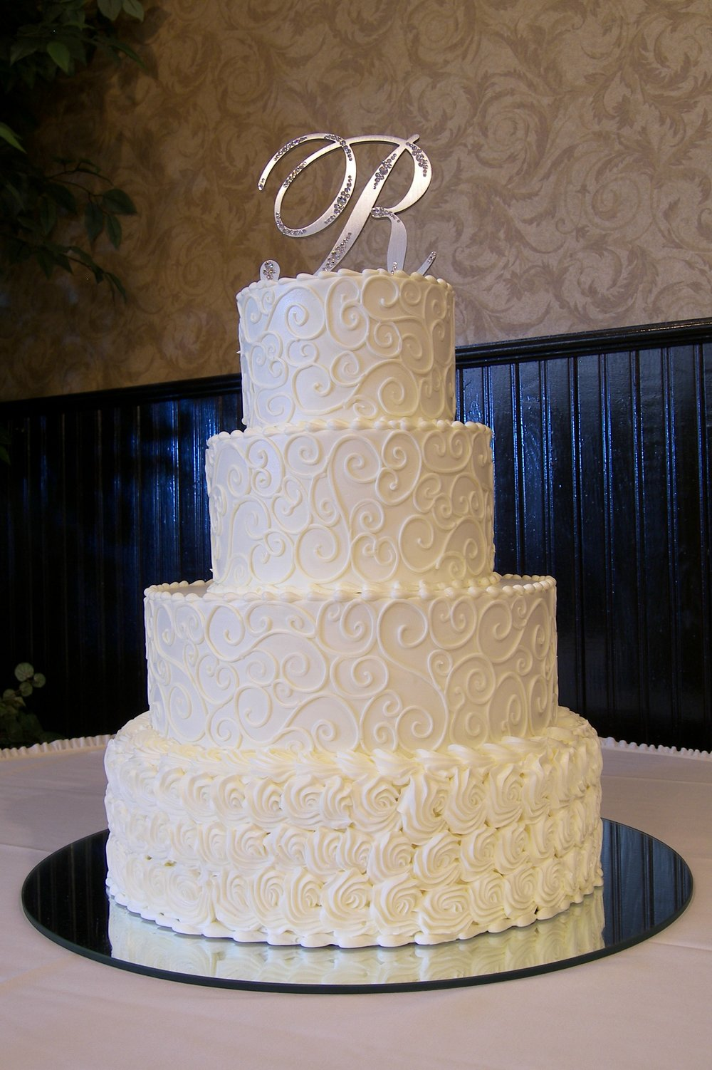 Wedding cake art design center buttercream our delicious buttercream cakes feature our decadent frosting between the cake layers and elegantly junglespirit Gallery
