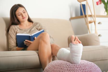 105396575_S_woman_injury_foot_ankle_cast_broken_book_elevate.jpg