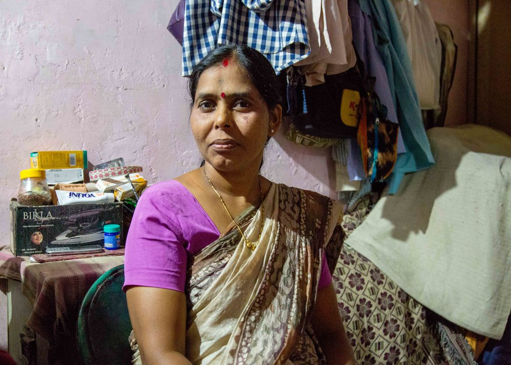 Akshay's mother inside her home