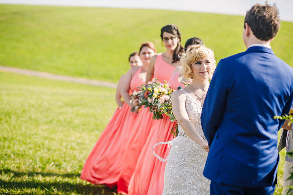 brielle-davis-events-photography-by-brea-linganore-winery-james-sarah-wedding-ceremony-bride-looking-at-groom.jpg