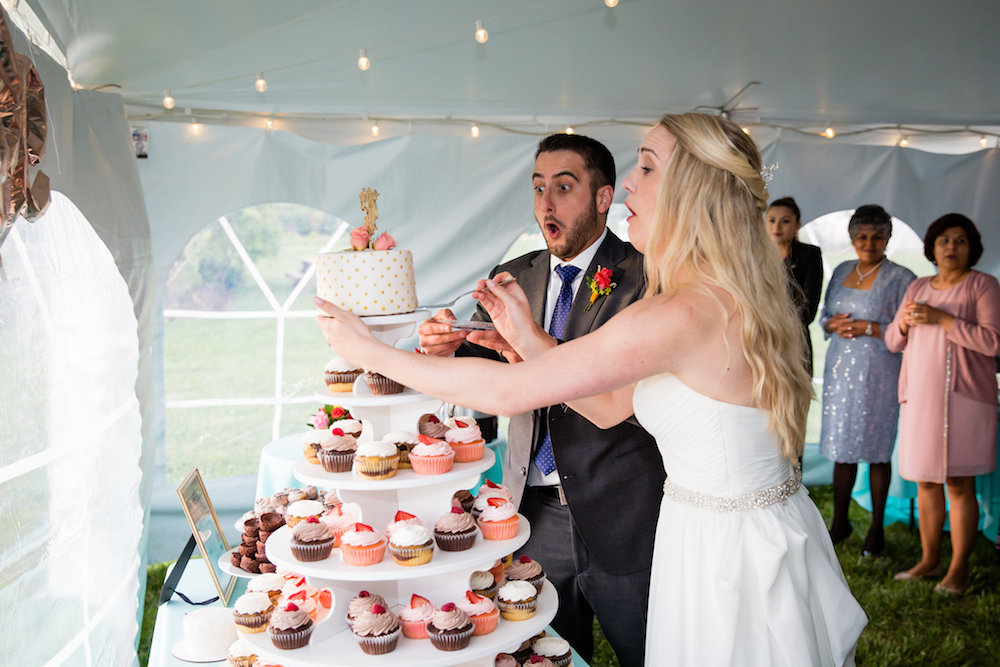brielle-davis-events-weatherly-farm-waterfront-wedding-reception-cake-falling.jpg
