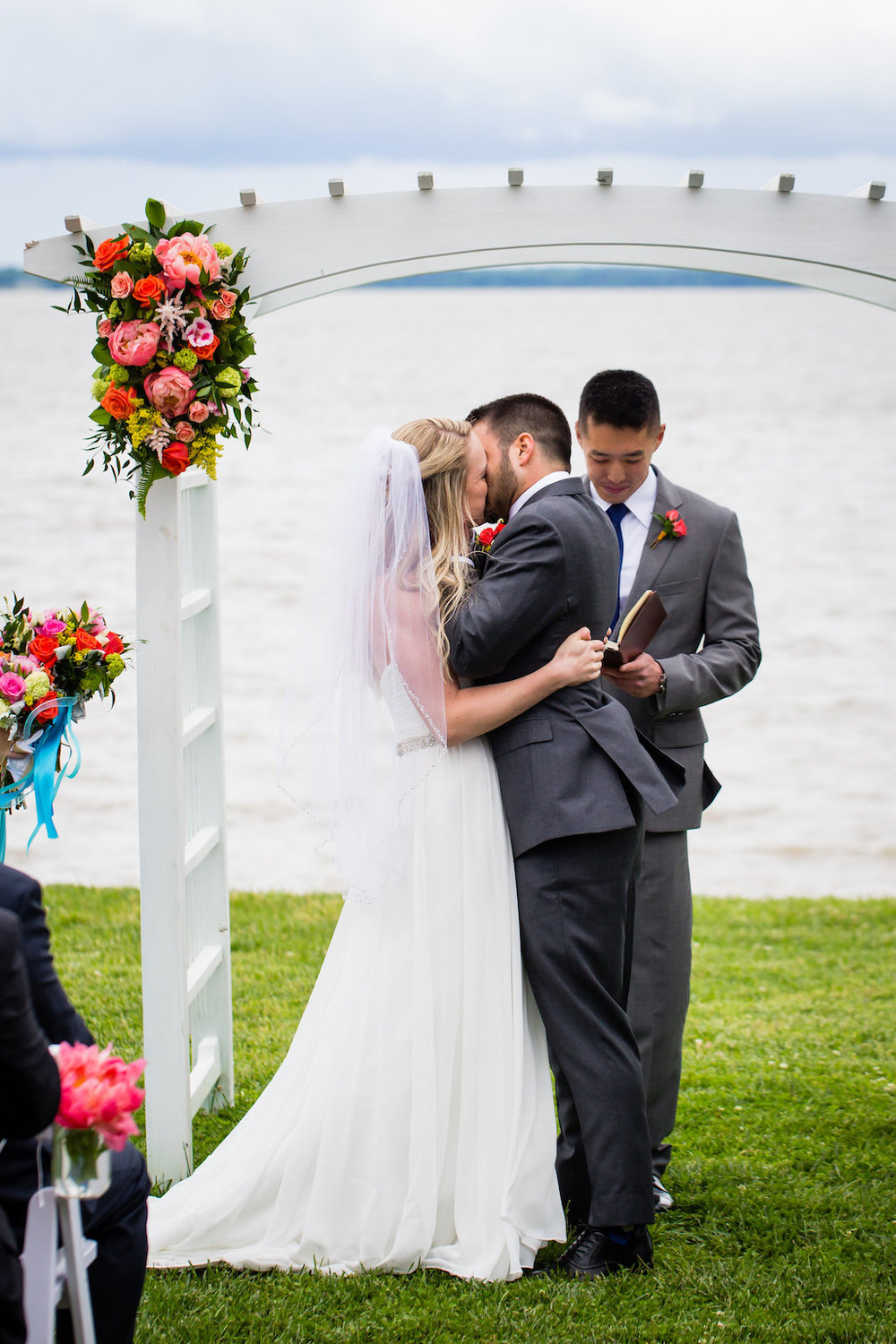 brielle-davis-events-weatherly-farm-waterfront-wedding-ceremony-kiss.jpg