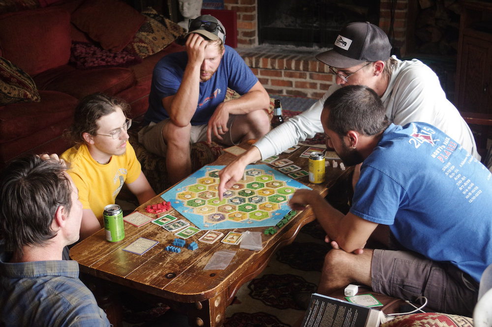 Not everything is work at the Lodge. The guides take a break from days of guiding to play a game of Settlers of Catan. Gabriel, (second from the right) explains the rules to a befuddled crowd.