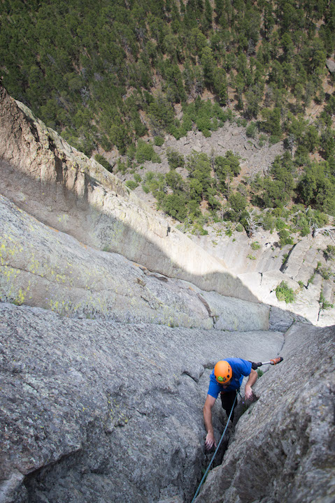 "Dave finishes the last few moves of ""Assembly Line"" (5.9) on the Northeast face of the tower. The route is famous for sustained hand-jams, where the climber wedges his whole hand and foot in the crack and advances upwards."